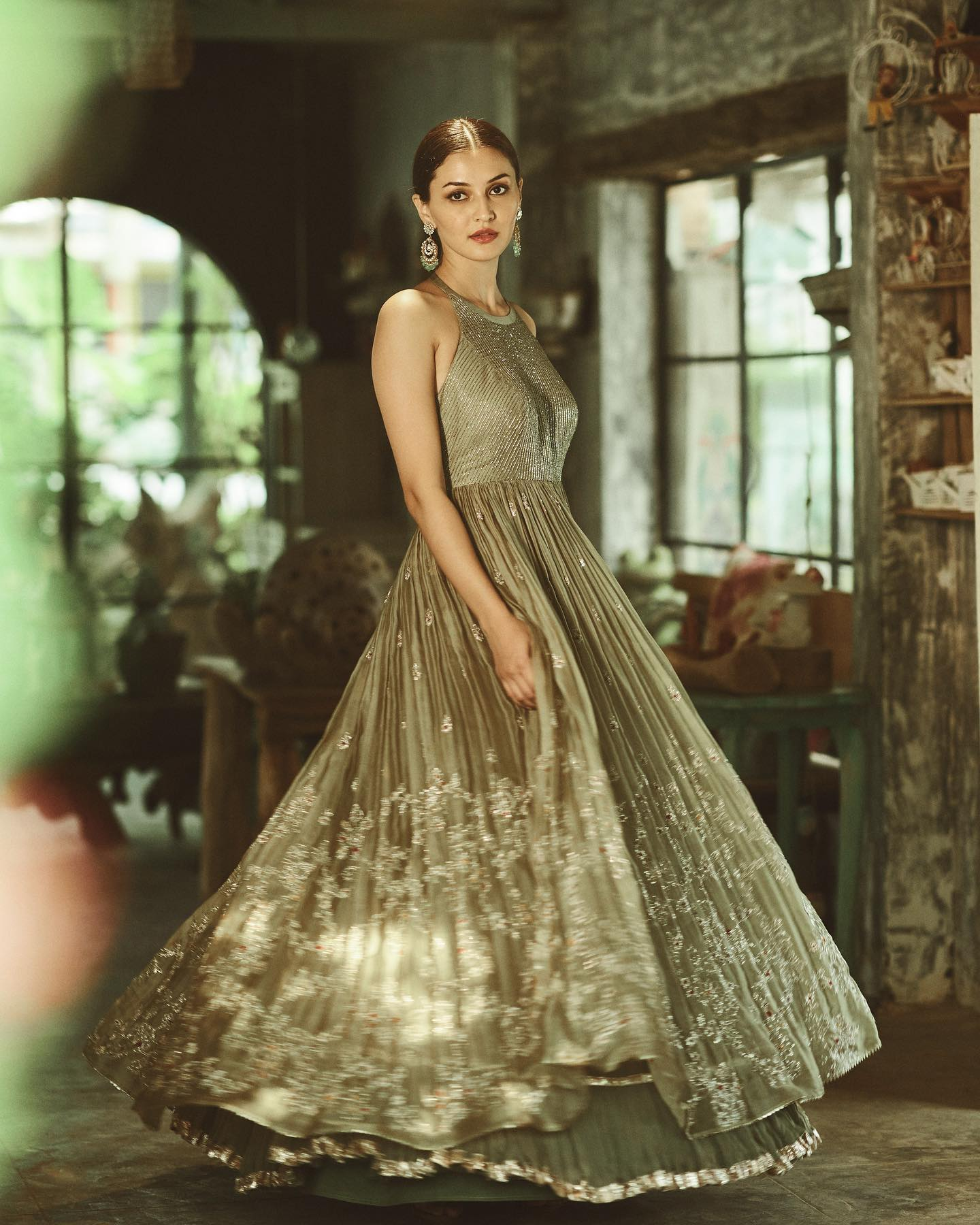 Phulwari . Gulshaat seen in  Rosemary green organza gown which has a cutdana torso and a halter neck and tie detailing. The bottom of the gown is double layered and has an intricate pita work floral jaal.  To shop our new collection Phulwari DM or Whatsapp  on +91 6302 878 533. 2021-06-07