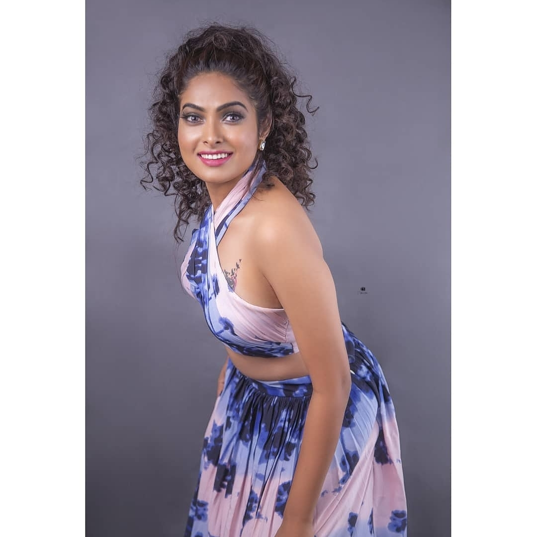 Beautiful actress Divi in white and blue tie die skirt and top. Wearing jahnavi varma label. 2021-06-07