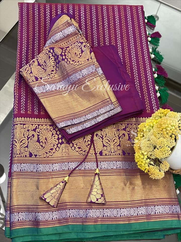 Type: Gadwal Silk Saree  Description: Megenta (kumkum color) Self Border with beautiful gold and silver zari border Gadwal Silk Saree complemented with patterned blouse !! Exclusively available @Sarayu .  Blouse: Yes  Fall and Pico: Yes  Inner Skirt : No  Price : 365$  Blouse size : 38/40  ✨ Beautiful & Rich Color Gadwal Silk ✨  2021-06-08