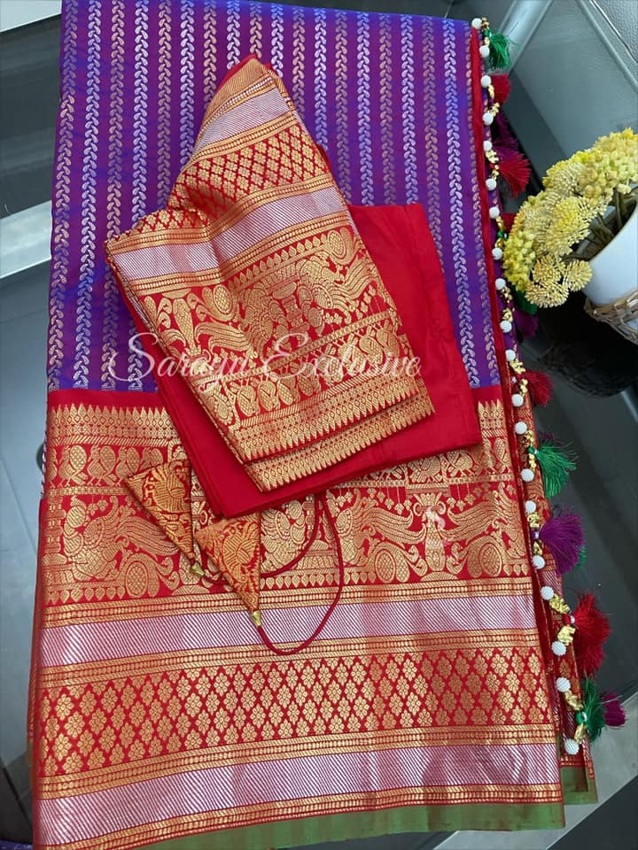 Type: Gadwal Silk Saree  Description: Deep purple with contrast red Border with beautiful gold and silver zari border Gadwal Silk Saree complemented with contrast red saree patterned blouse !! Exclusively available @Sarayu .  Blouse: Yes  Fall and Pico: Yes  Inner Skirt : No  Price : 365$  Blouse size : 38/40  ✨ Beautiful & Rich Color Gadwal Silk ✨ 2021-06-08