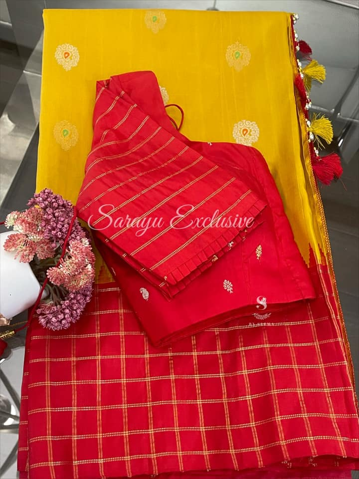 Type: Gadwal Silk  Description: Beautiful Gandham yellow with Red Gadwal Silk Saree with checks and temple border and meena buti with complemented with designer gold and silver pallu with red patterned blouse !! Exclusively available @Sarayu .  Blouse: Yes  Fall and Pico: Yes  Inner Skirt : No  Price : 335 $  Blouse size : 38/40  ✨ Gadwal Silk in Traditional Bright Hues ✨ 2021-06-08