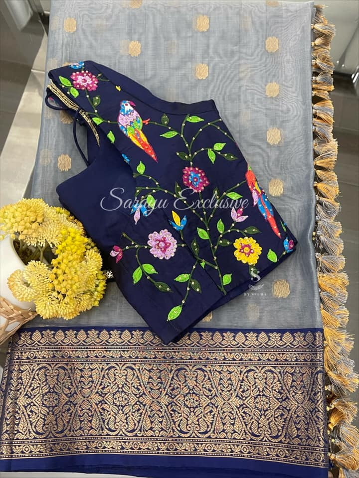 Type : Pure Chanderi Silk sarees description: Grey and Blue border chanderi silk saree complemented with outside contrast blue rawsilk paithani inspired maggam work blouse !!  *Price : 265*( saree patterned blouse 235)  size 38/40 !  * Beautiful  light weight Saree * 2021-06-08