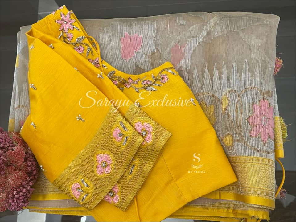 Type: Banarasi Kora Silks.  Description: Beige and yellow Fine Quality Banarasi Kora Silk complemented Handworked contrast yellow Saree Blouse ! Exclusively available @Sarayu .  Blouse: Yes  Fall and Pico: Yes  Inner Skirt : Yes  Price : 245$ Blouse size : 38/40 *Beautiful Kora Silk in light sober color combo * 2021-06-08