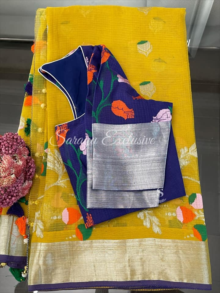 Type: Kota Zari  Description: Beautiful yellow Kota zari saree complemented with silver kaddi borders and paired with contrast beautiful deep blue patterned Saree blouse ! Exclusively available @Sarayu .  Blouse: Yes  Fall and Pico: Yes  Inner Skirt : Yes  Price : 345$  Blouse size : 38/40 *Beautiful Yellow and blue combo Kota Silk *  2021-06-08