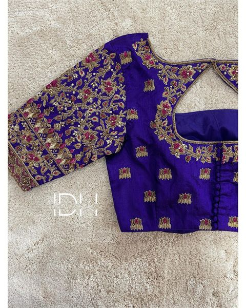 Stunning royal blue color blouse design with lotus flower buti hand embroidery maggam work.   2021-06-08