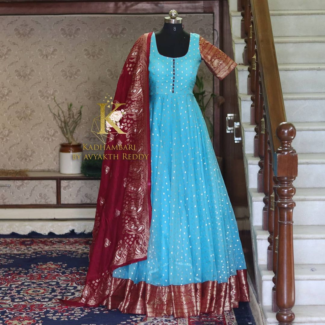 Stunning sky blue and maroon color combination pattu long frock with maroon pattu dupatta. This outfit is Available at Rs 6800/- 2021-06-08
