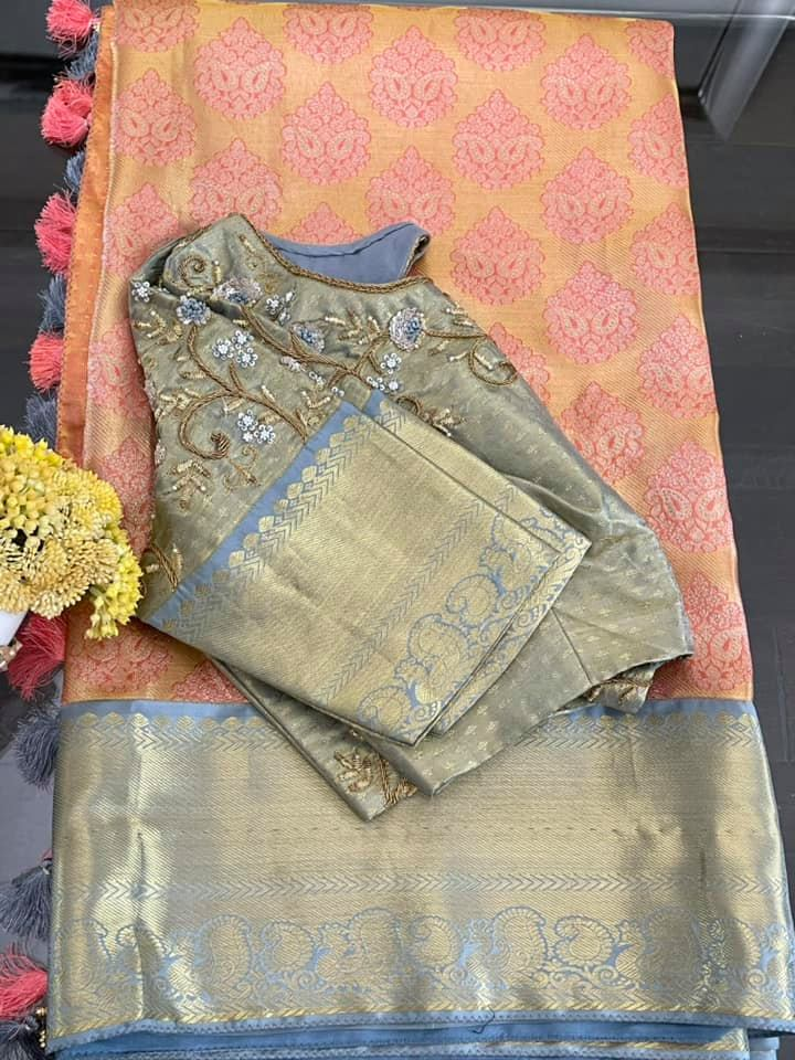 Type: Kanchi Pattu.  Description: Peach pink and light grey Kanchi Tissue Pattu Saree paired with all over hand worked saree blouse .  Blouse: Yes  Fall and Pico: Yes  Inner Skirt : Yes  Price : 435$  Blouse size : 38/40 *Beautiful Rich Kanchi silk in delicate hues . * 2021-06-09