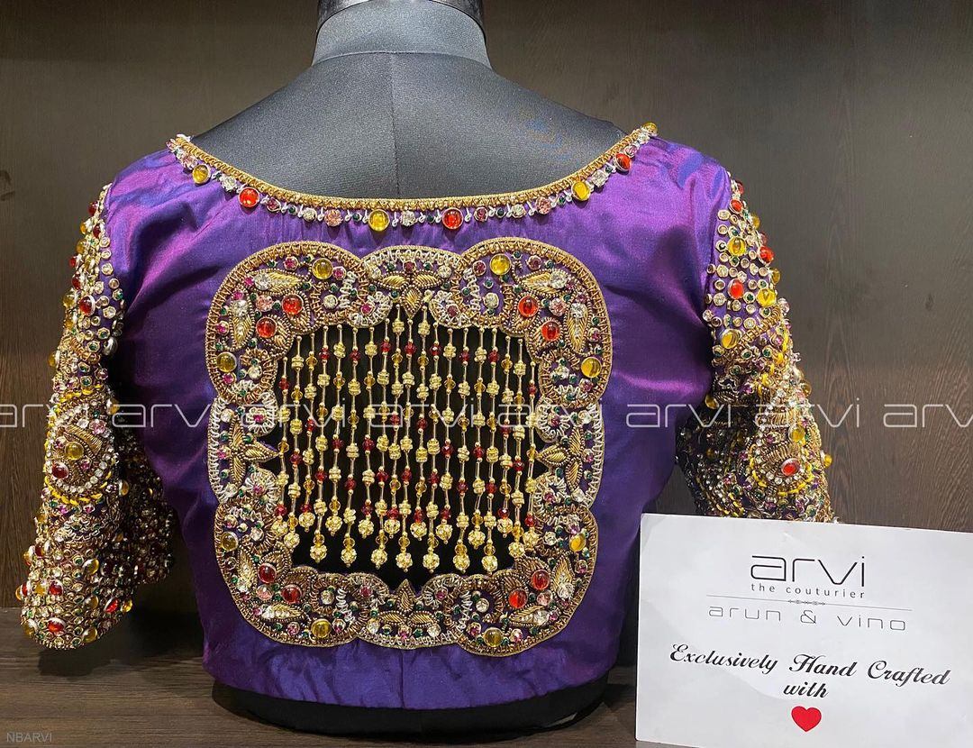 Stunning purple color designer blouse design with hand embroidery multi color stone work.  2021-06-09