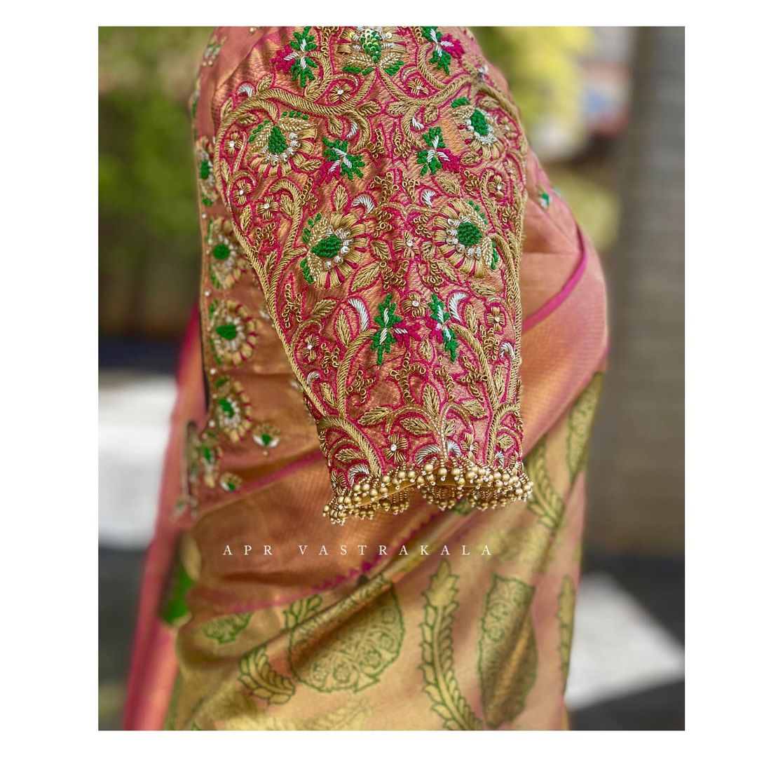 Exclusive blouse detailings!! Gorgeous pink brocade bridal blouse sleeve with hand embroiderer floral maggam work.  2021-06-09