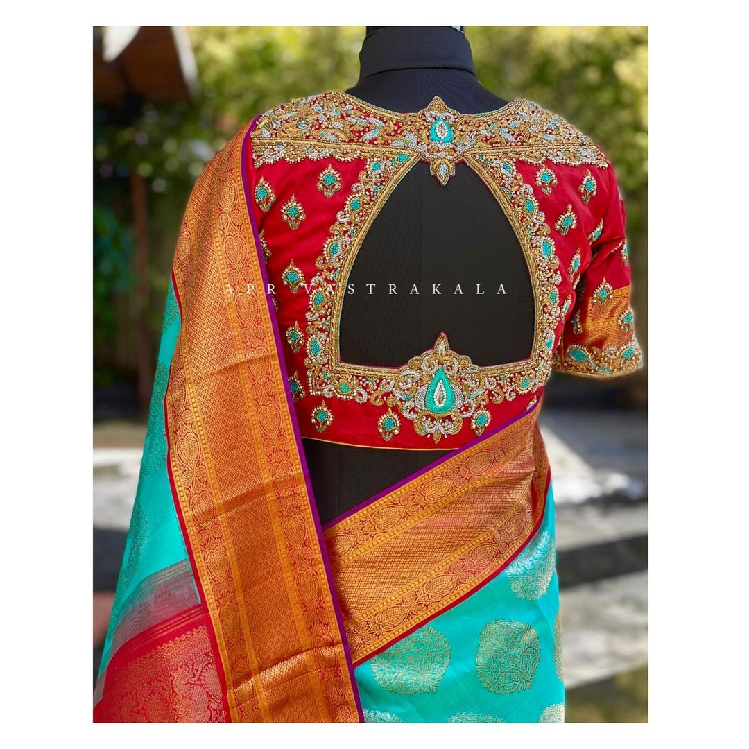 Gorgeous red color bridal blouse with classy hand embroidery bead aari work.  2021-06-09