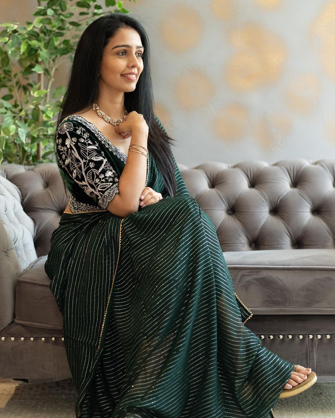 Signature Velvet embellished Blouse with Stripes Saree in New Bottle Green shade. 2021-06-09