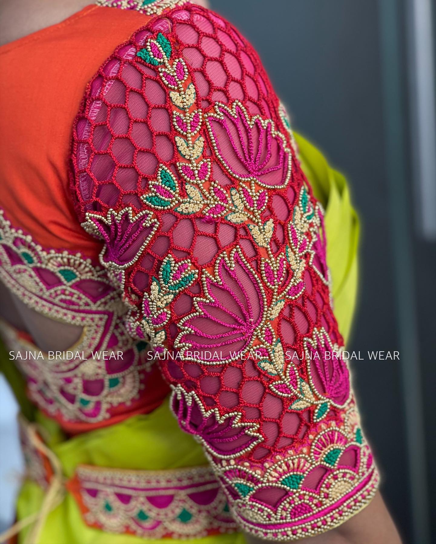 Cut work blouse with cut work waist belt. Stunning pink and orange color combination blouse design with lotus flower hand embroidery cut work on sleeves.  2021-06-10