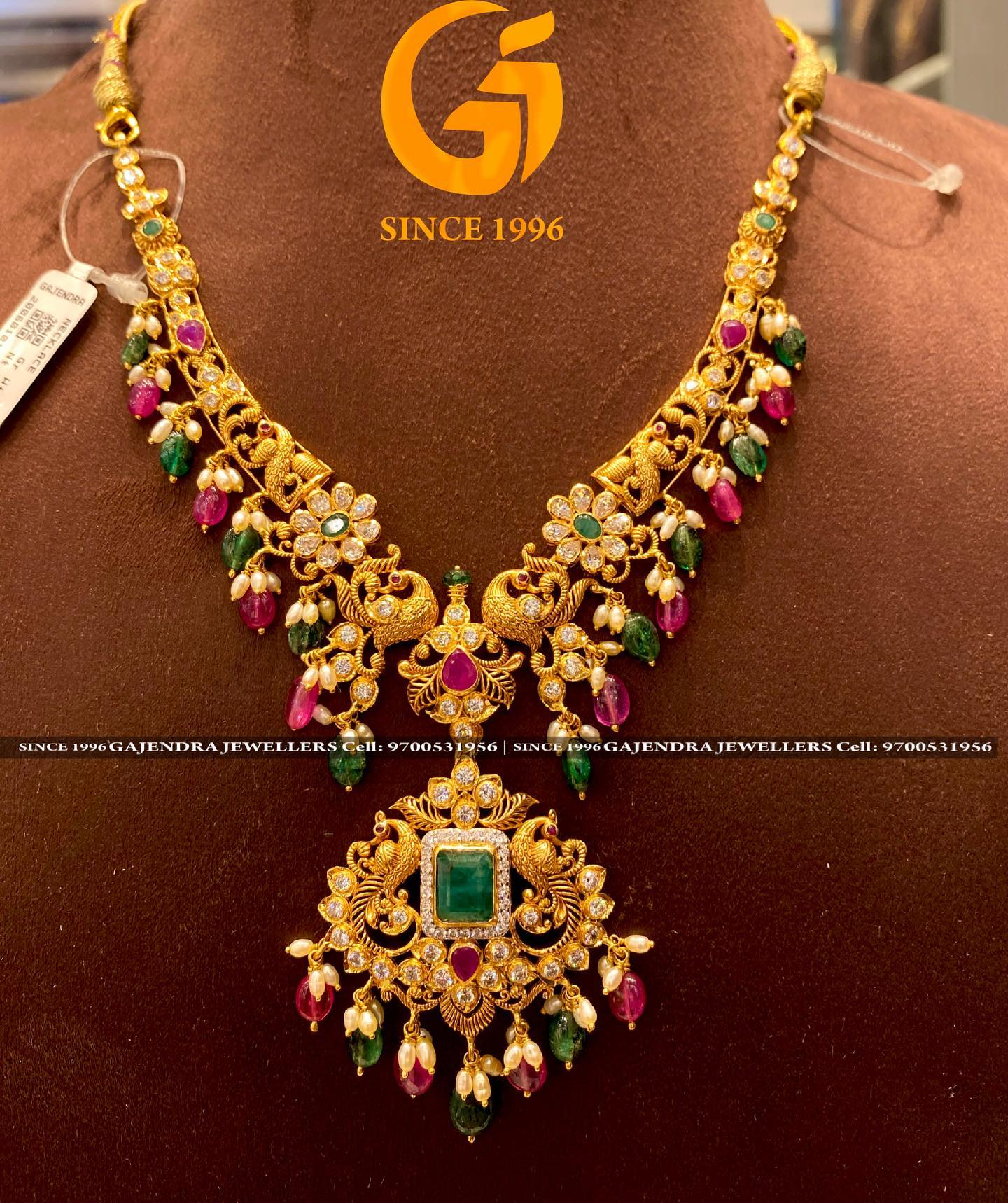 Gorgeous 22k gold necklace with peacock nakshi work studded with multi color precious stones. 2021-06-10