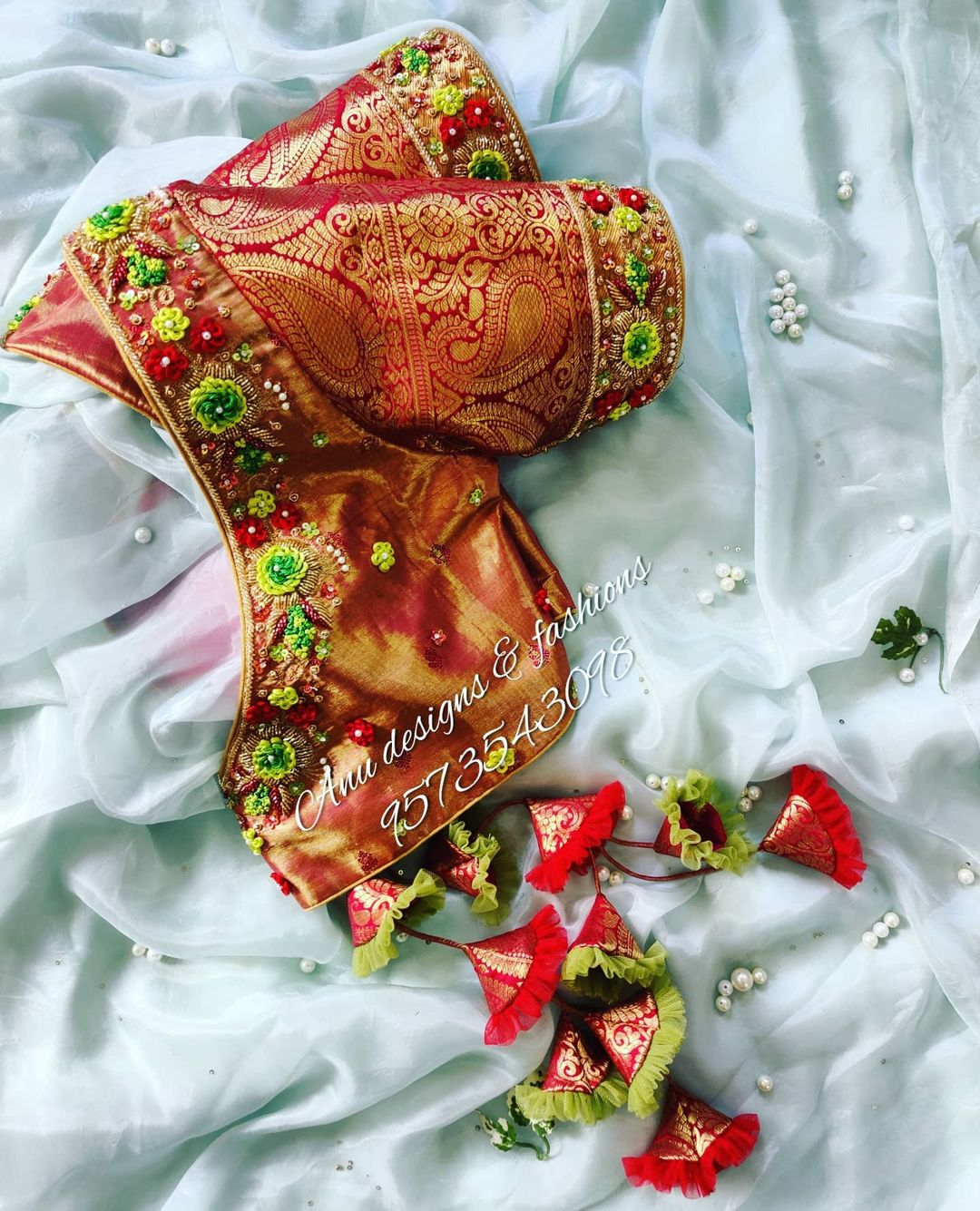 Beautiful kanchi silk bridal blouse design with floral hand embroidery 3D maggam work on V neckline and sleeves.  2021-06-10