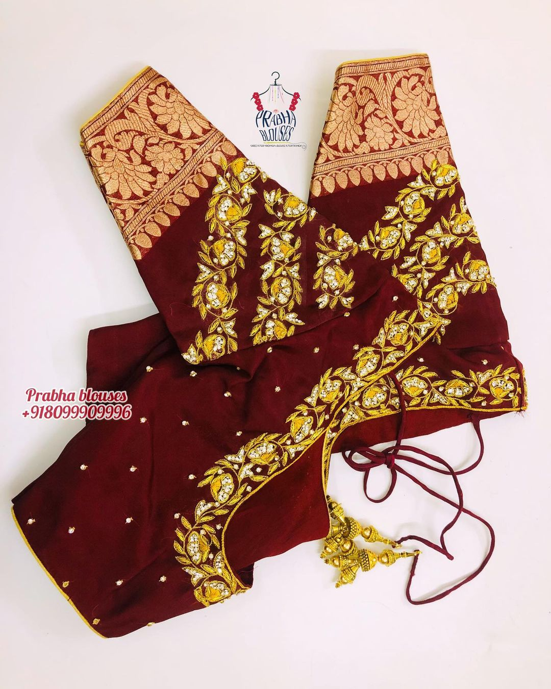 Stunning maroon color bridal blouse design with creeper gold thread and stone maggam work. 2021-06-10