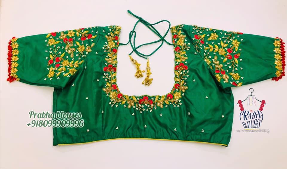 Stunning green color bridal blouse design with creeper hand embroidery bead and thread maggam work on neckline and sleeves.   2021-06-11