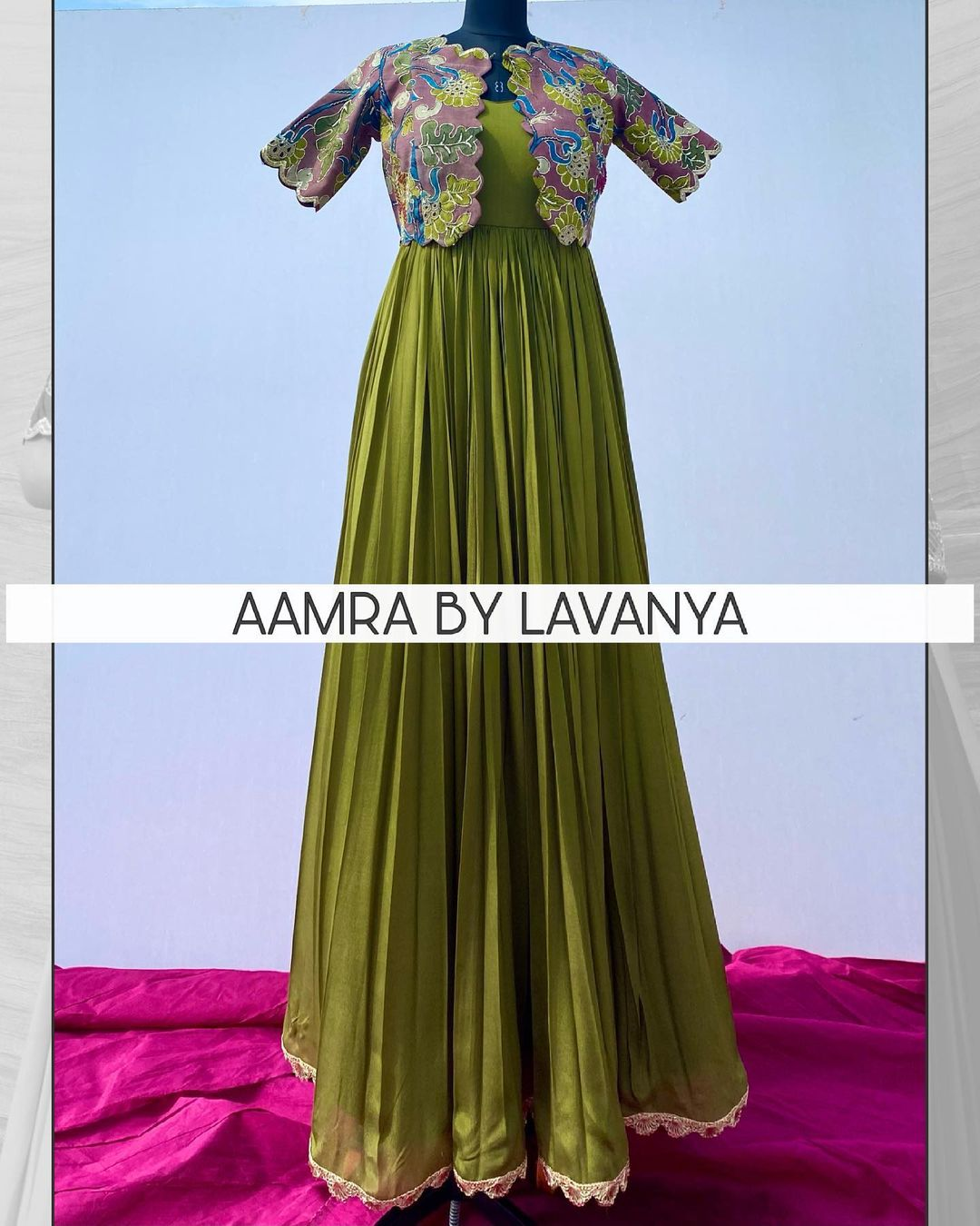 Long dress in olive green shade paired with a hand painted kalamkari silk jacket with all over hand embroidery. For orders and queries call/whatsapp on +91-9177363970. 2021-06-11