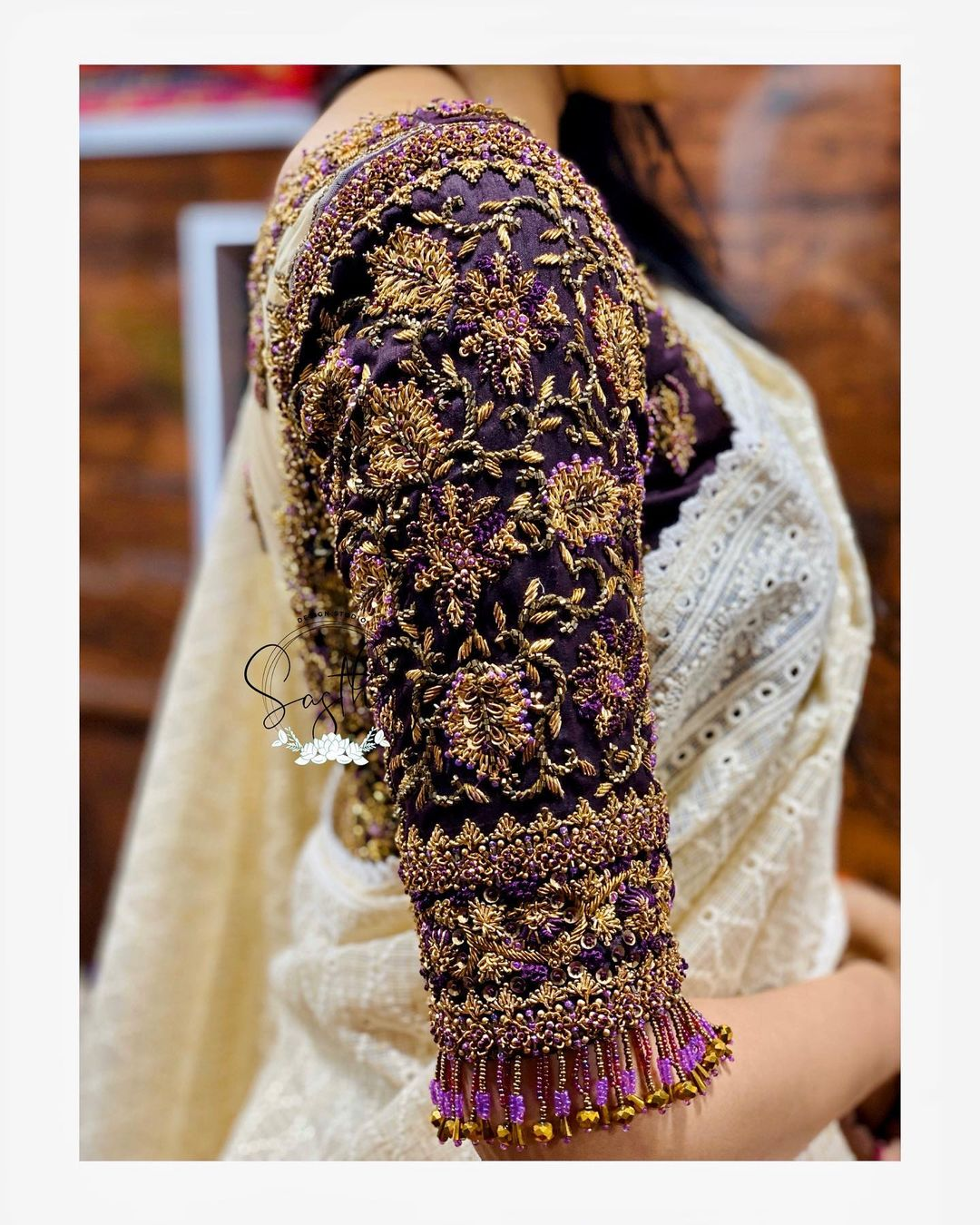 Stunning thick wine color bridal blouse sleeve design with floral bead aari work. 2021-06-11