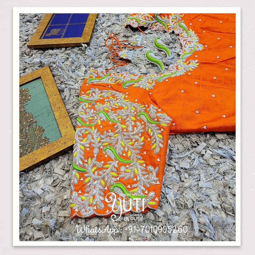 Stunning orange color blouse design with leaf creeper hand embroidery silver thread maggam work.  2021-06-11