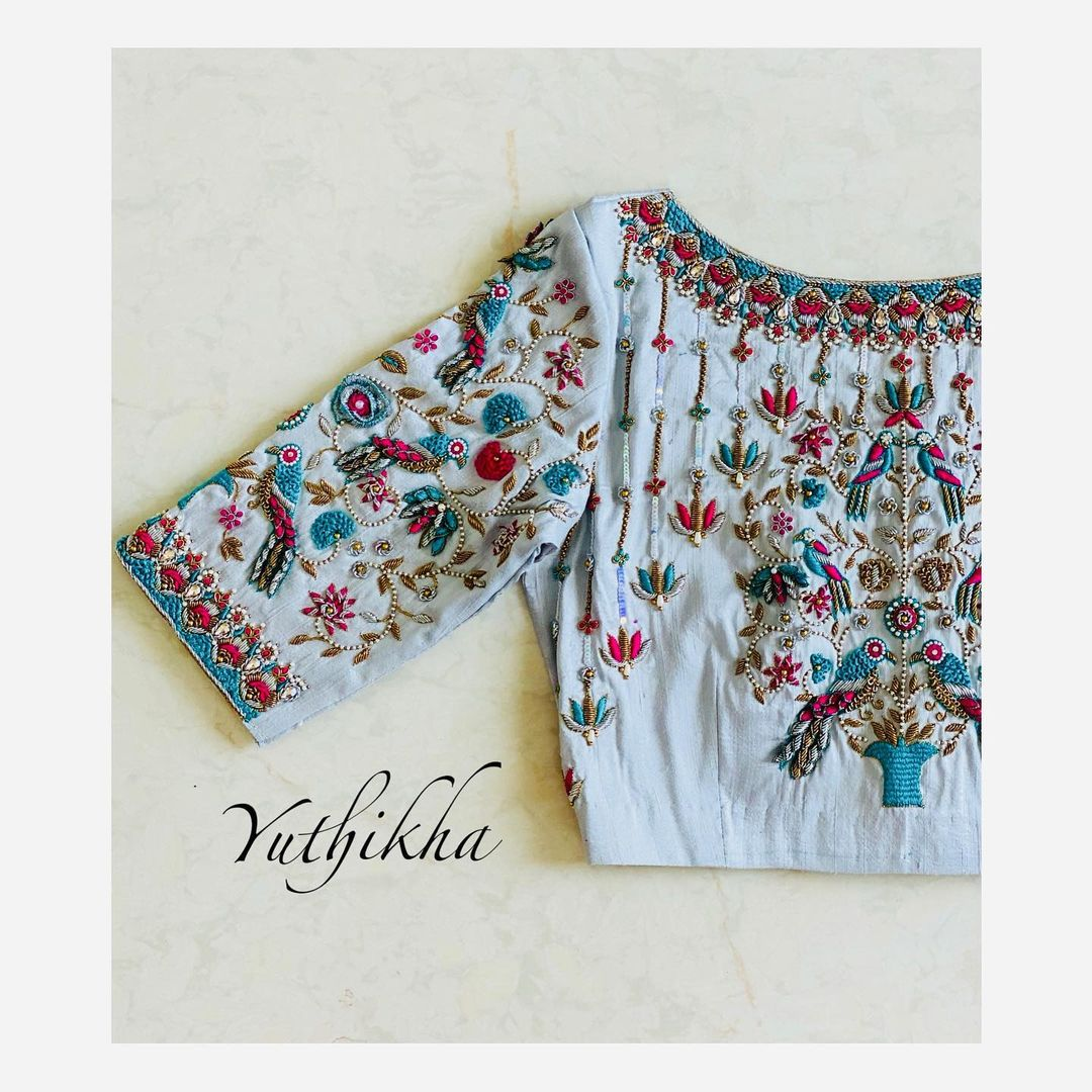 Love  With 3D embroidery blouse from the house of Yuthikha designer studio!!! Stunning blouse design with parrots and florals 3D maggam work. 2021-06-11