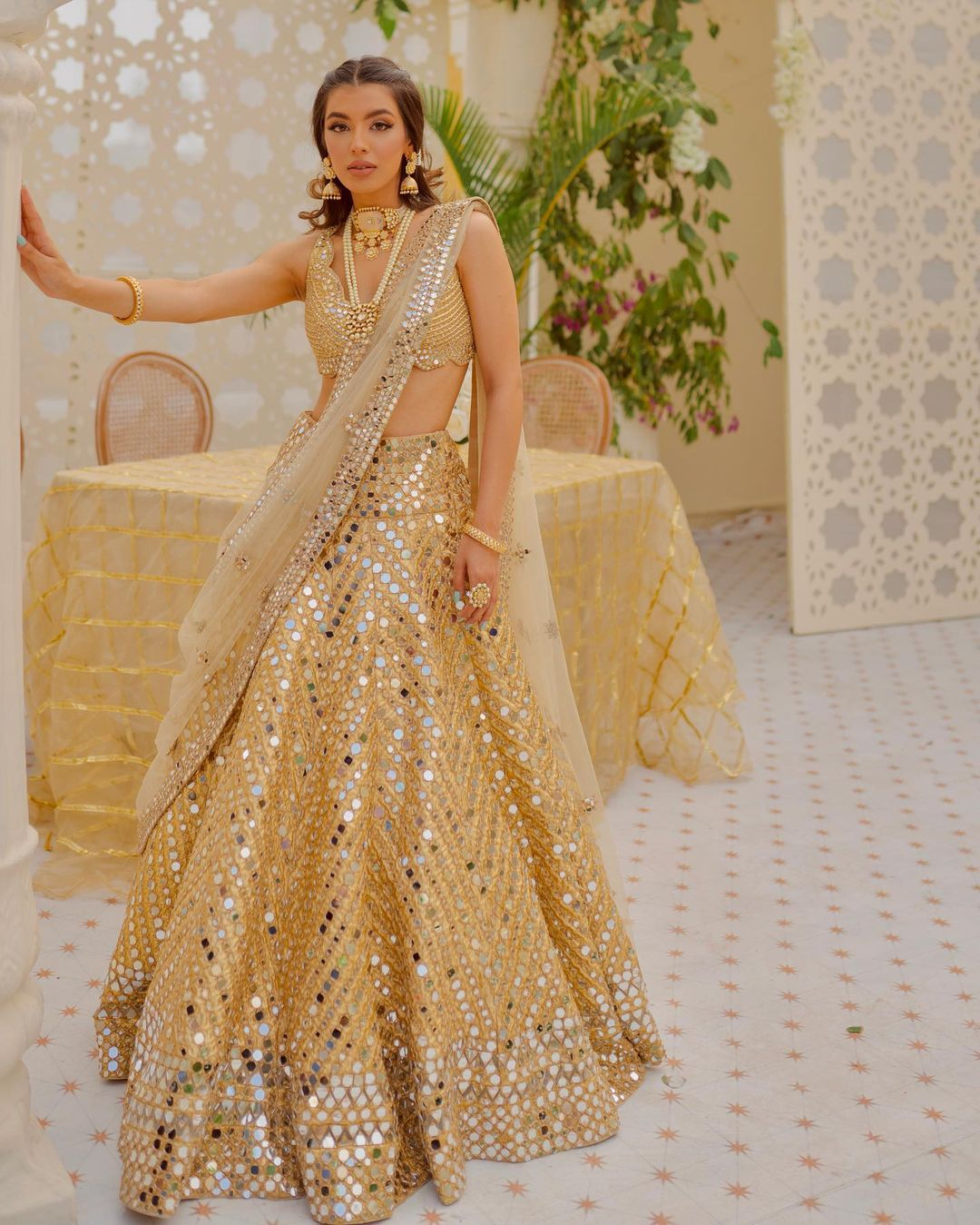Stunning off white bridal lehenga design with hand embroidery mirror work.  2021-06-11