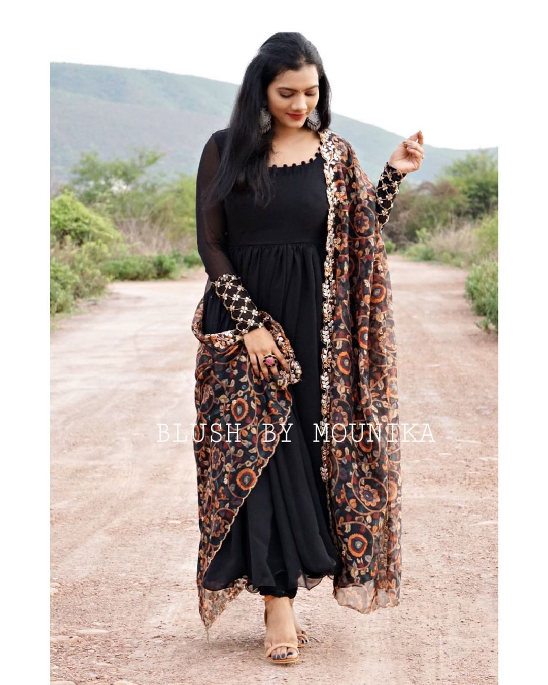 Lila. Price :  ₹4850.  Black Georggette dress and gathered pants paired with floral print organza dupatta. The dress have zari thread machine embroidery for the cuffs. 2021-06-12