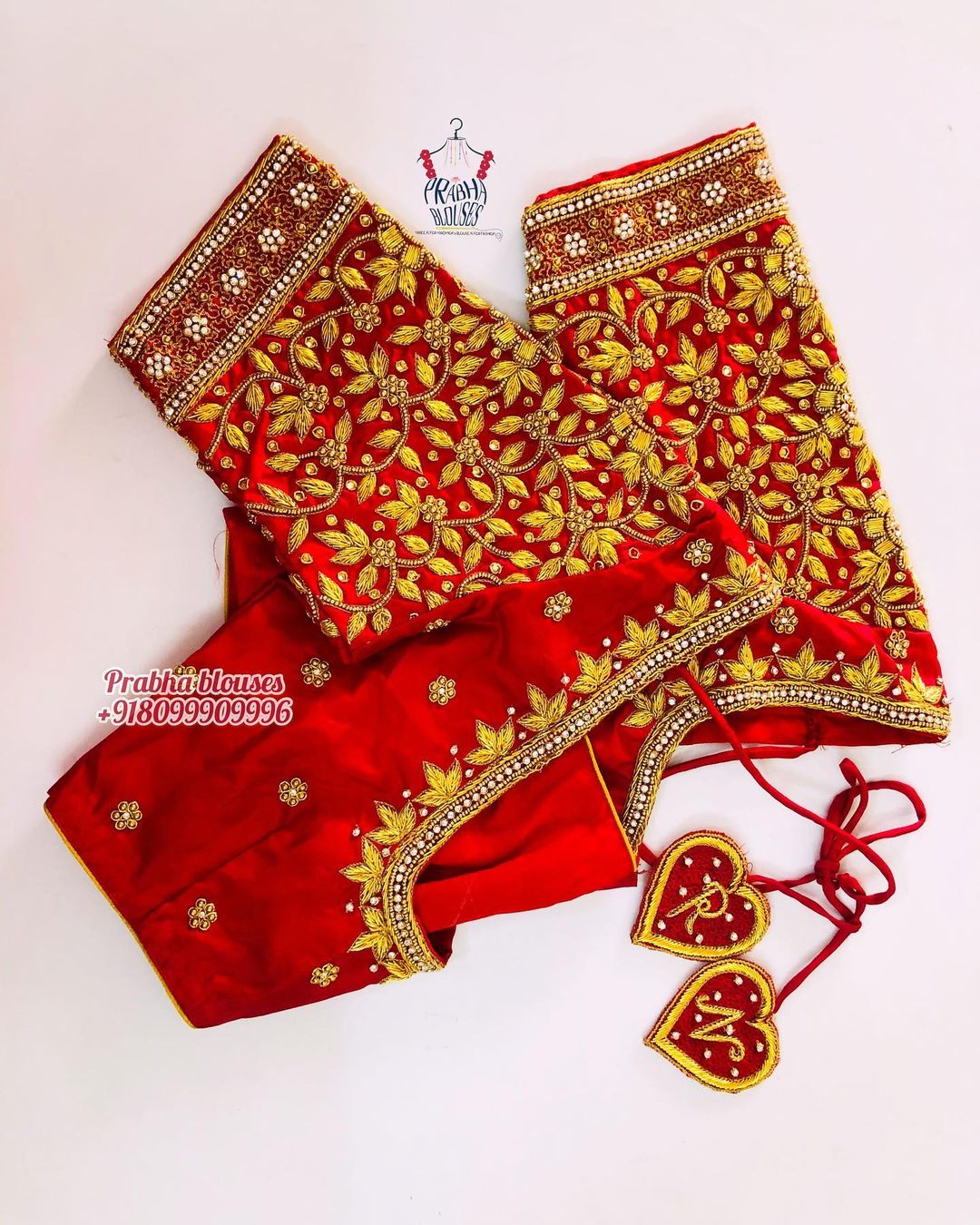 Stunning red color bridal blouse with creeper maggam work. 2021-06-12