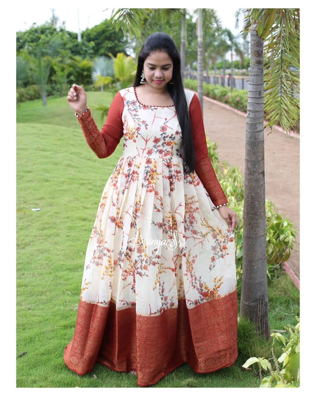 Off white floral traditional long frock! ! Orange Bloom. Price :  RS. 2650/- Off white floral traditional long frock with contrast orange border and sleeves . 2021-06-12