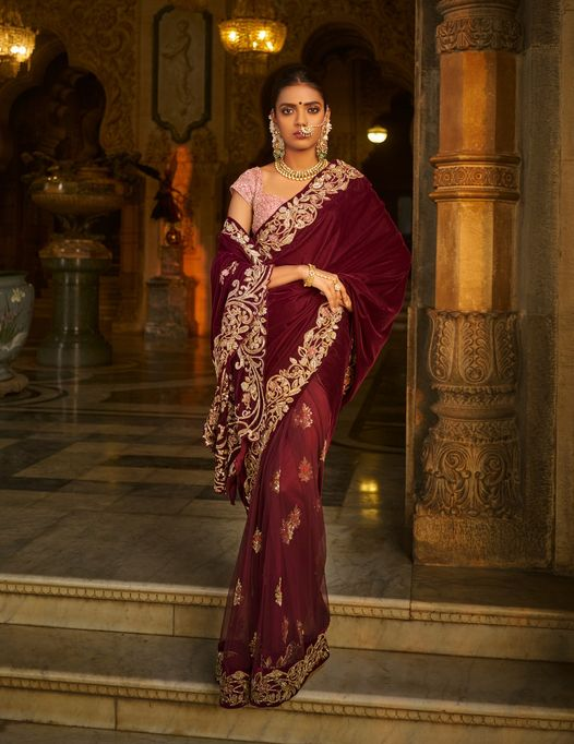 "The rich wine velvet zardosi bel kinaar sari with gilded baroque zardozi embroidery. . ""MEMOIRS OF A MAHARANI"" SHYAMAL & BHUMIKA . Kindly WhatsApp  on +91-9833520520 for more information. 2021-06-13"