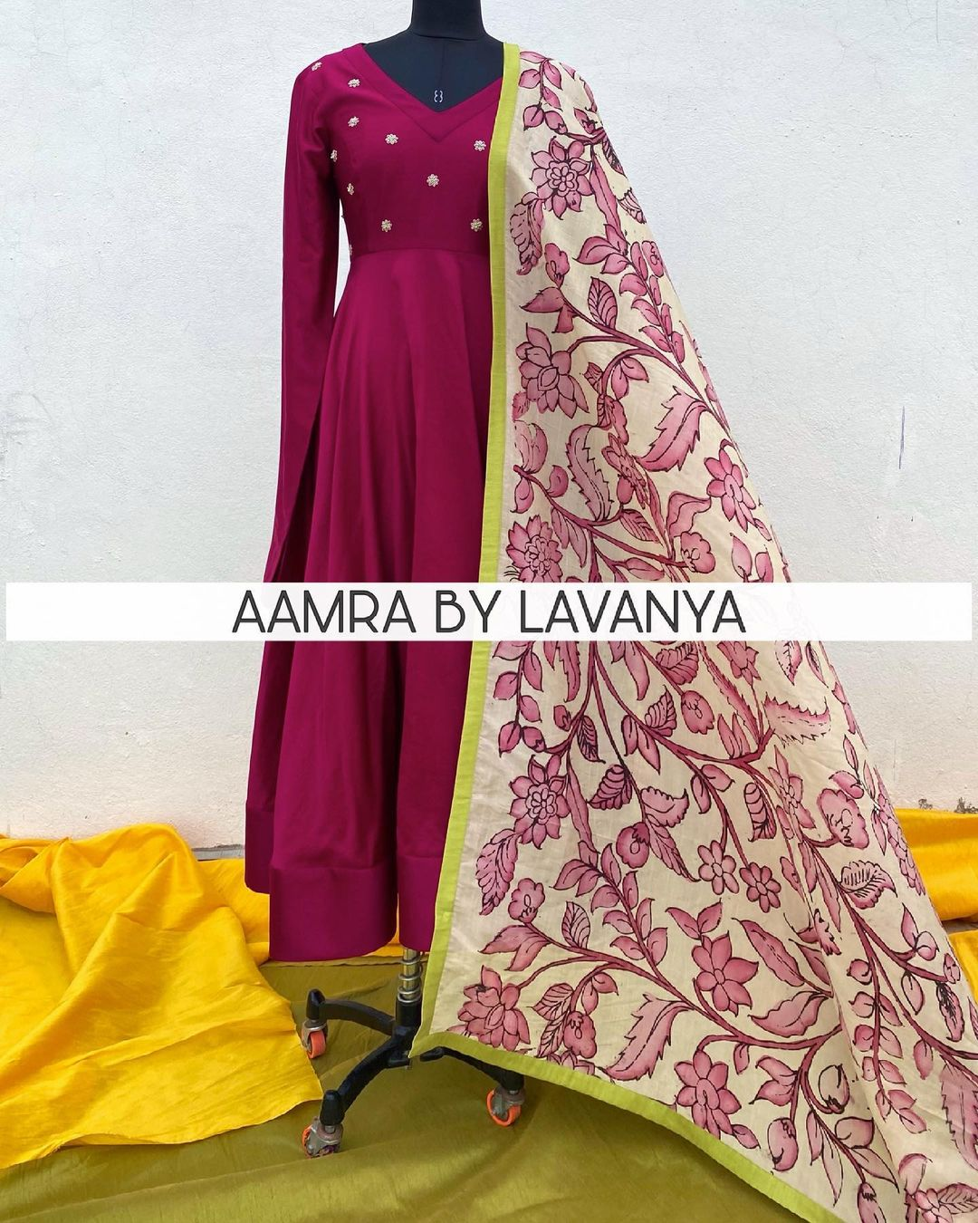 Burgundy anarkali with hand embroidered butis on yoke teamed with hand painted pen kalamkari silk dupatta. For orders and queries call/whatsapp on +91-9177363970. 2021-06-13