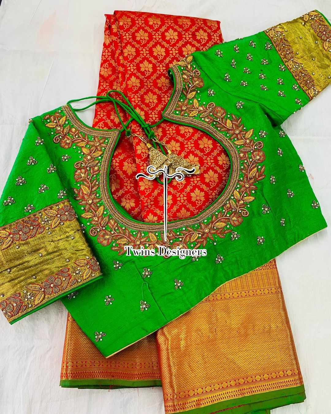 Pure kanjeevaram saree paired with green contrast hand made maggam work blouse . 2021-06-13
