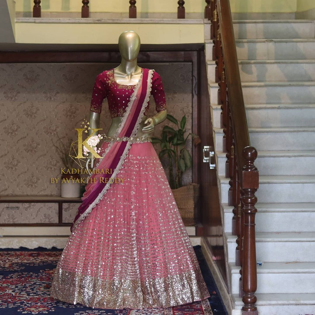 Net bridal lehenga!! Stunning blush pink color bridal net lehenga and wine color blouse with net dupatta. Blouse with hand embroidery work.  2021-06-13