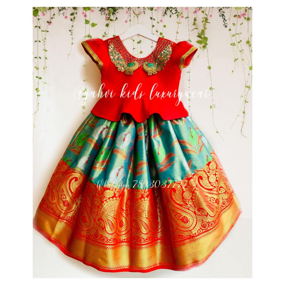Kanchi tissue kids lehanga!!! Blouse : hand embroidery work pecock design in Peter pan collar peplum blouse . Lehanga : colours of pecock in Kanchi tissue kids lehanga . For orders : DM or whatsapp 7893037777( messages only  no calls plz )  2021-06-14