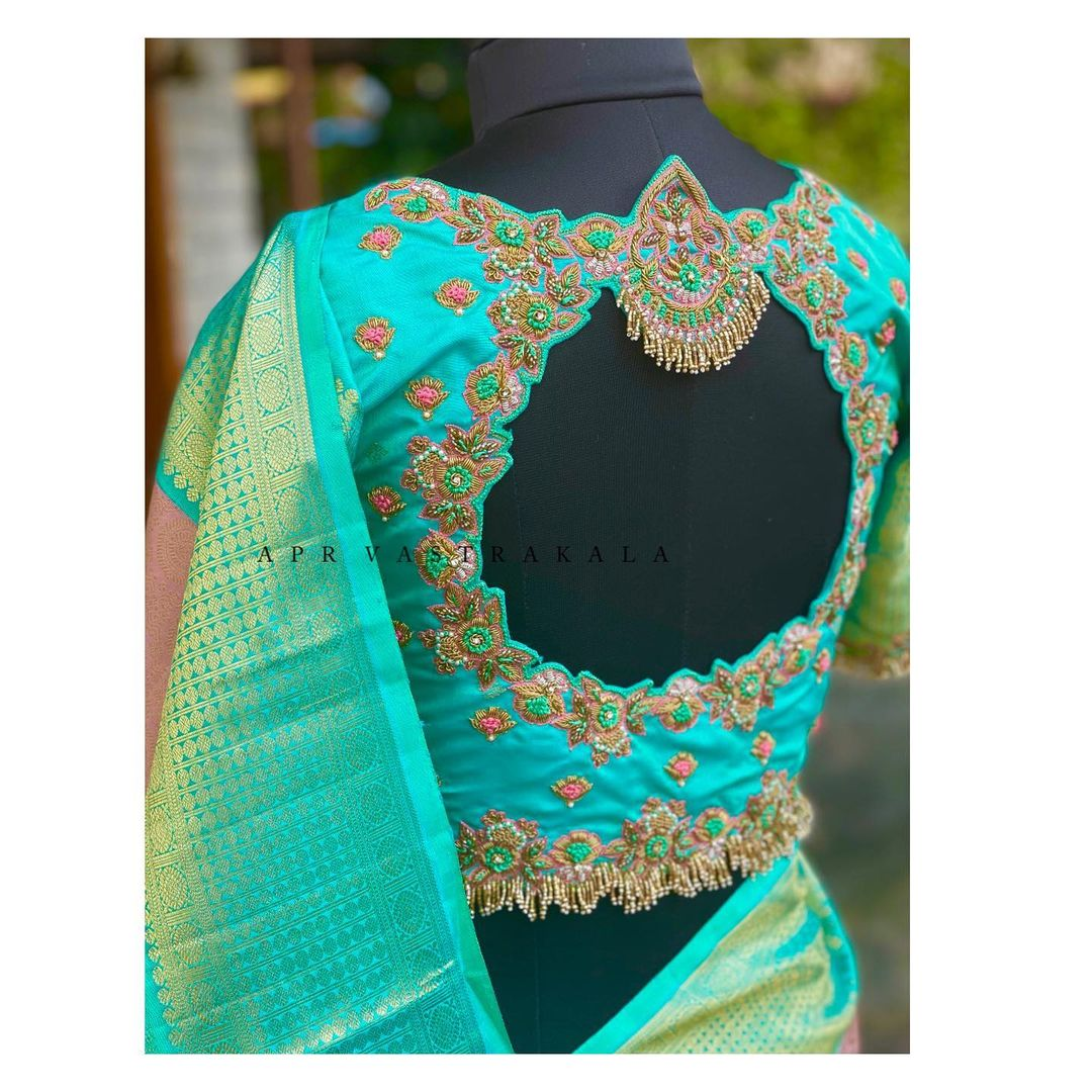 Exclusive blouse detailings!! Gorgeous sea green color bridal jewel blouse design with floral creeper hand embroidery thread aari work.  2021-06-14