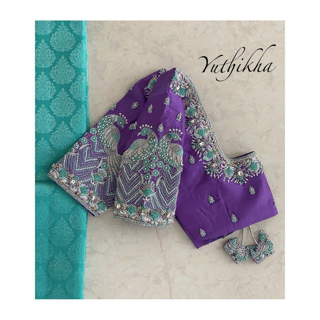 peacock aari work blouse design!! Stunning purple color blouse design with peacock and floral hand embroidery silver thread and bead aari work.  2021-06-14