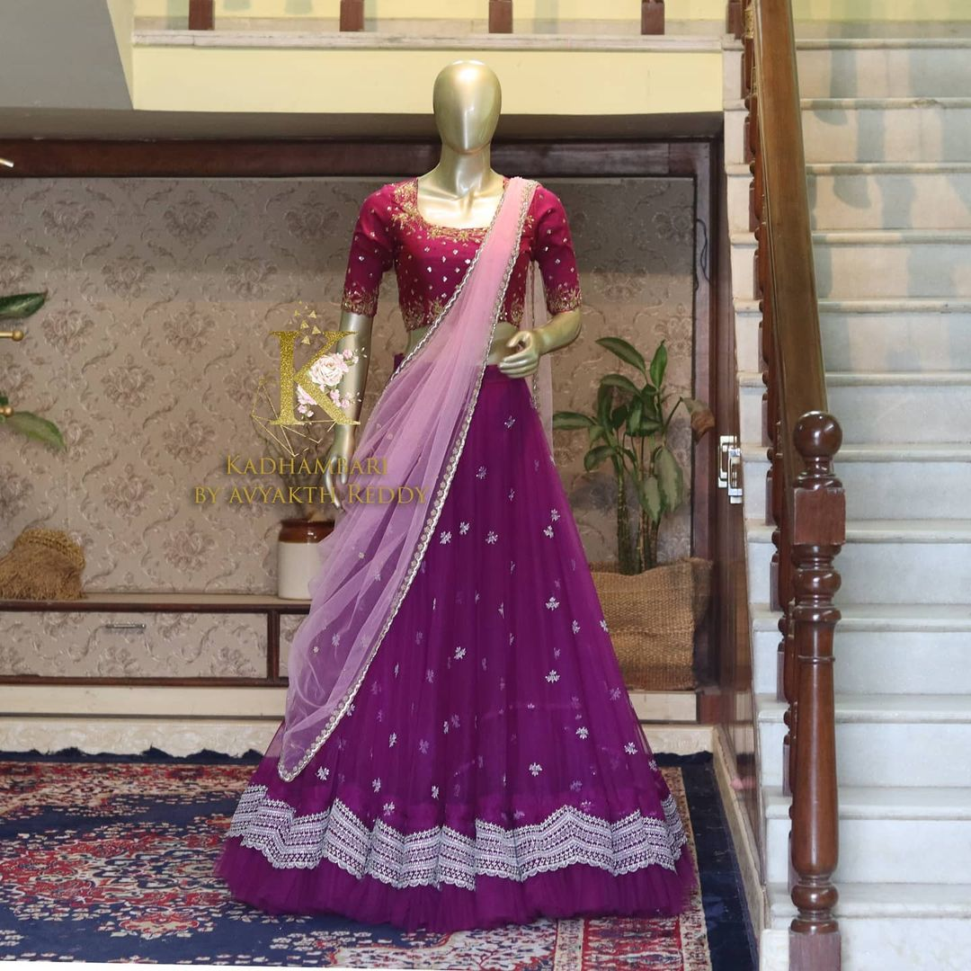 Gorgeous purple net lehenga and wine blouse with net dupatta.  This outfit is Available at Rs 14800/- 2021-06-14