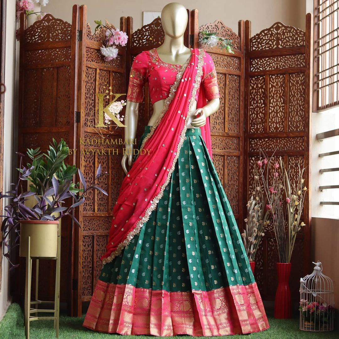 Beautiful bottle green and pink color combination pattu langa and pink blouse with net dupatta. Blouse with embroidery work.  2021-06-14