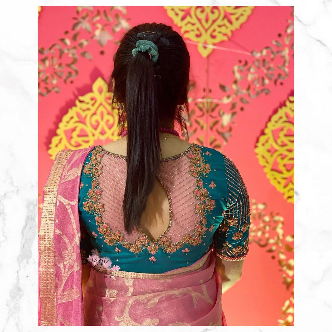 Beautiful turquoise blue color sheer back blouse with floral hand embroidery aari work.   2021-06-15