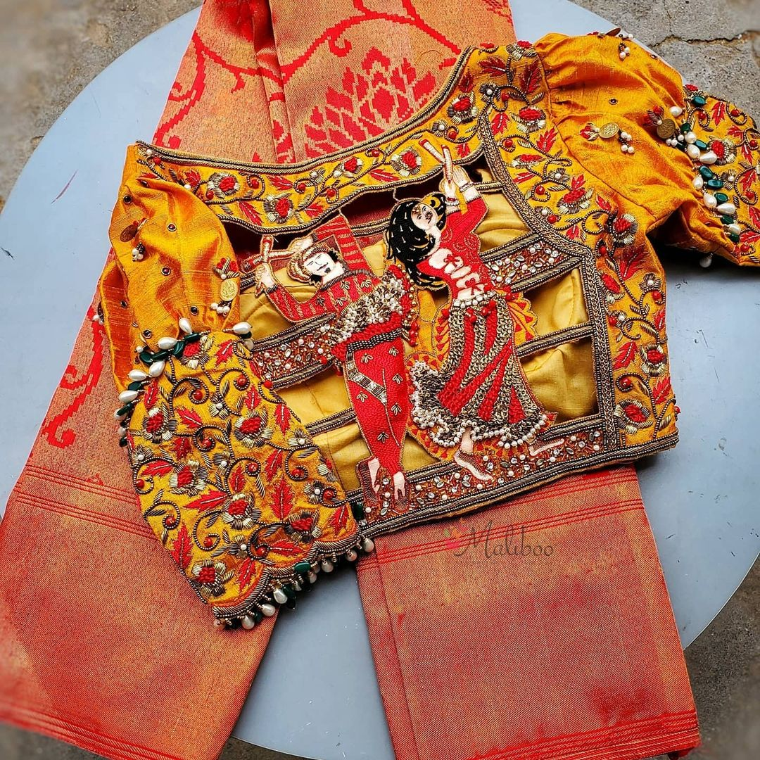 Stunning mustard yellow color bridal blouse with marriage dance design hand embroidery maggam work on back of blouse.   2021-06-15