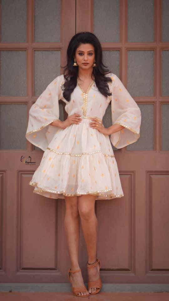 Beautiful actress Priyamani in white knee length gown.  2021-06-16