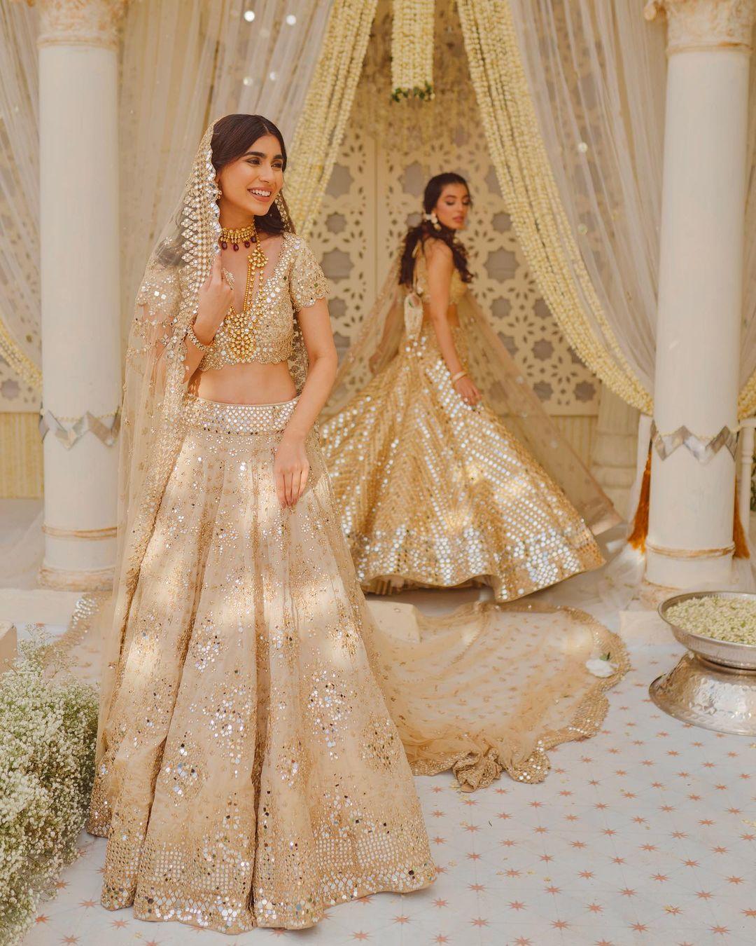 Stunning gold shade bridal lehenga set with hand  embroidery mirror work. 2021-06-16