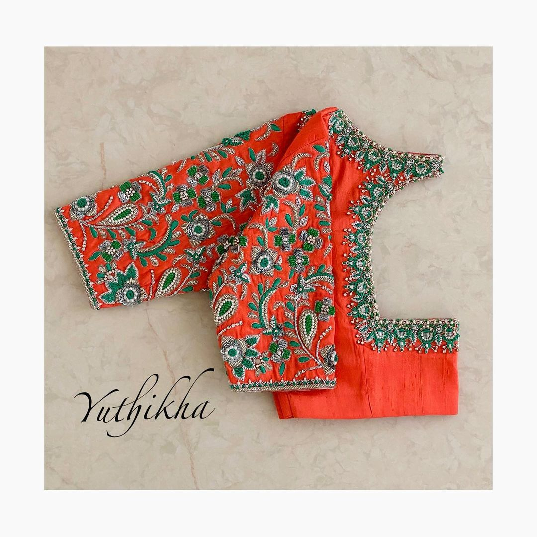 Intricate Floral embroidery blouse designs!! Stunning orange shade bridal blouse with floral embroidery thread and bead aari work.  2021-06-16