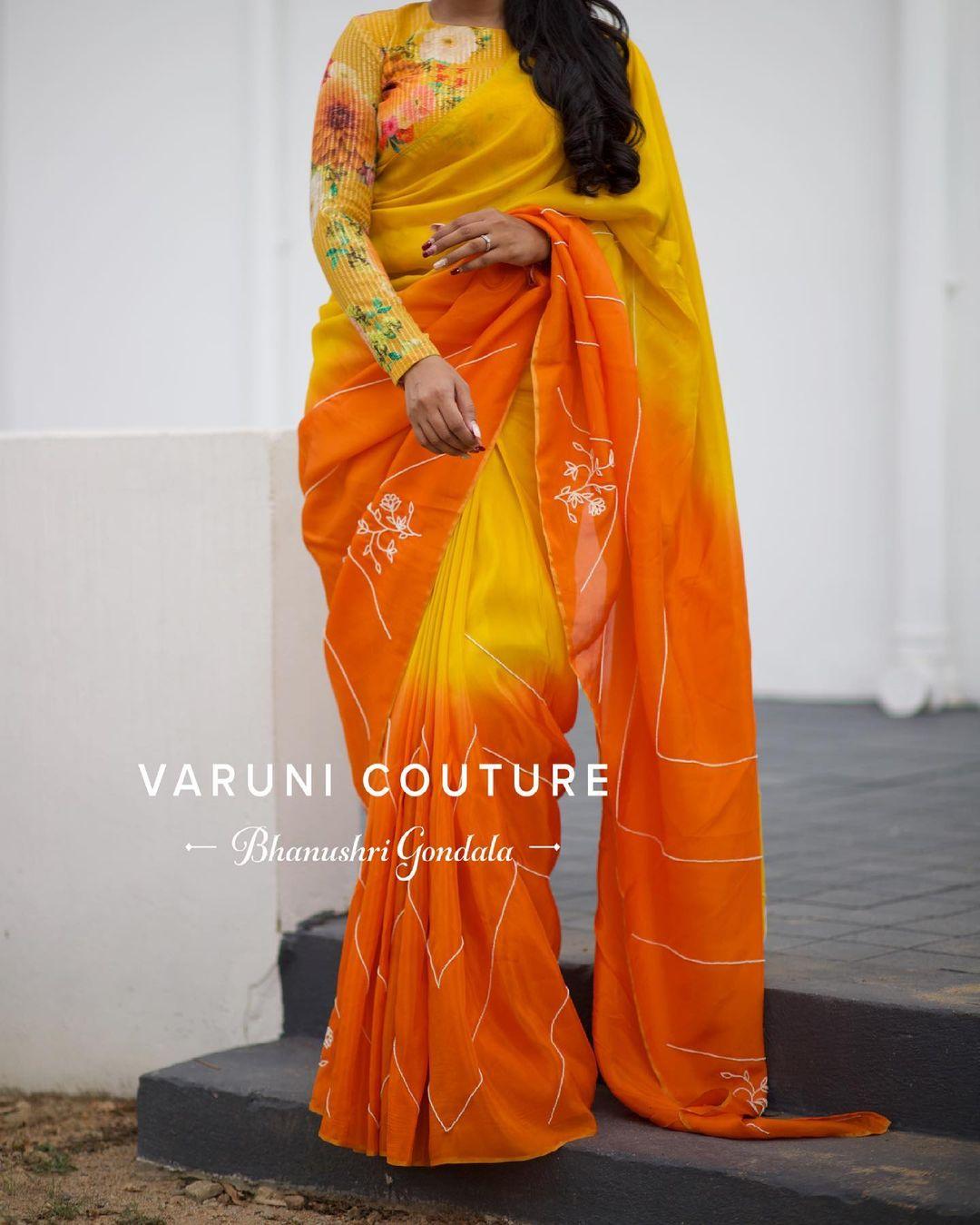 Stunning yellow and orange shade designer uppada silk saree with floral full sleeve blouse.  2021-06-16