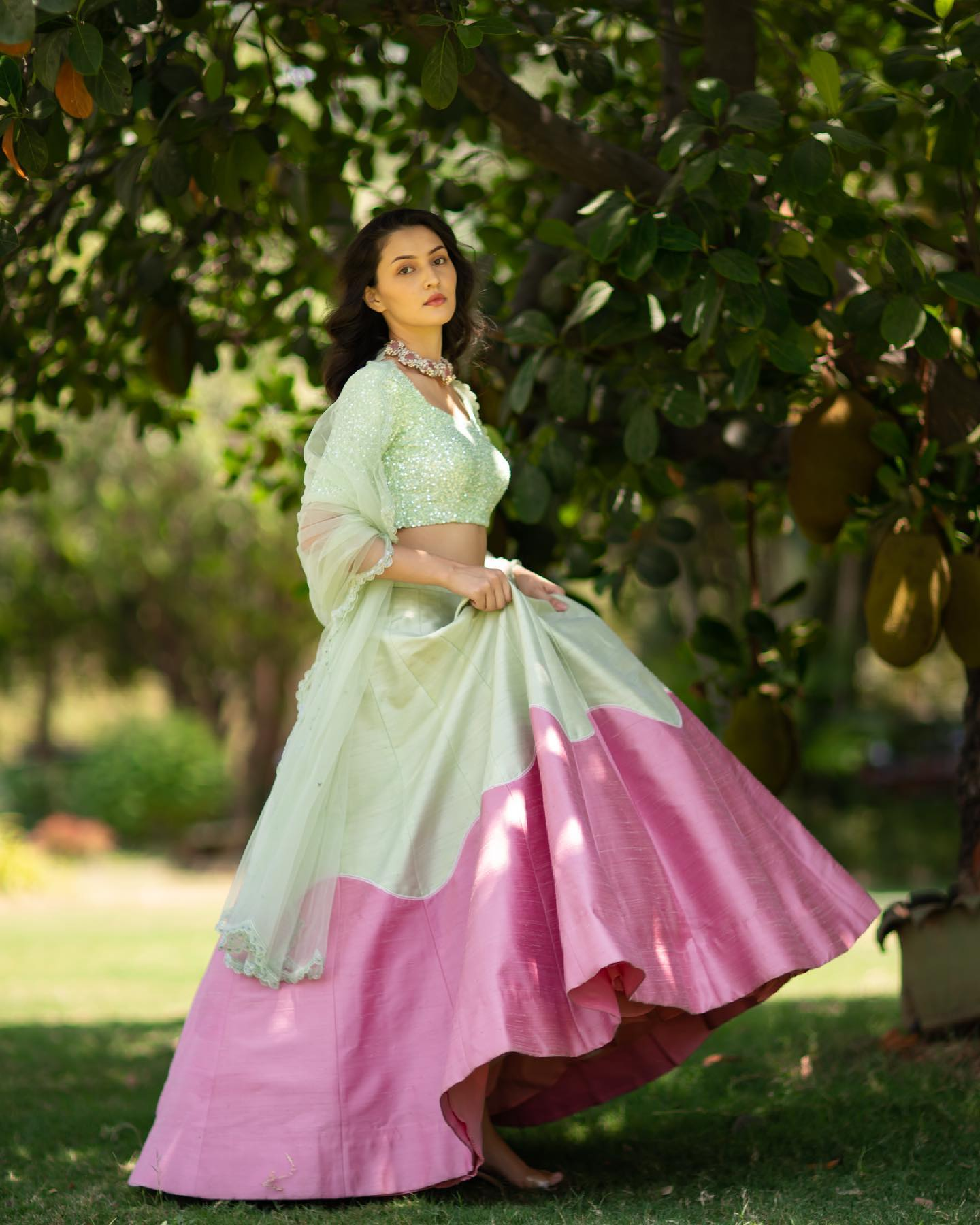Stunning olive green and pink color combination bridal lehenga and sequin blouse with net dupatta. 2021-06-17