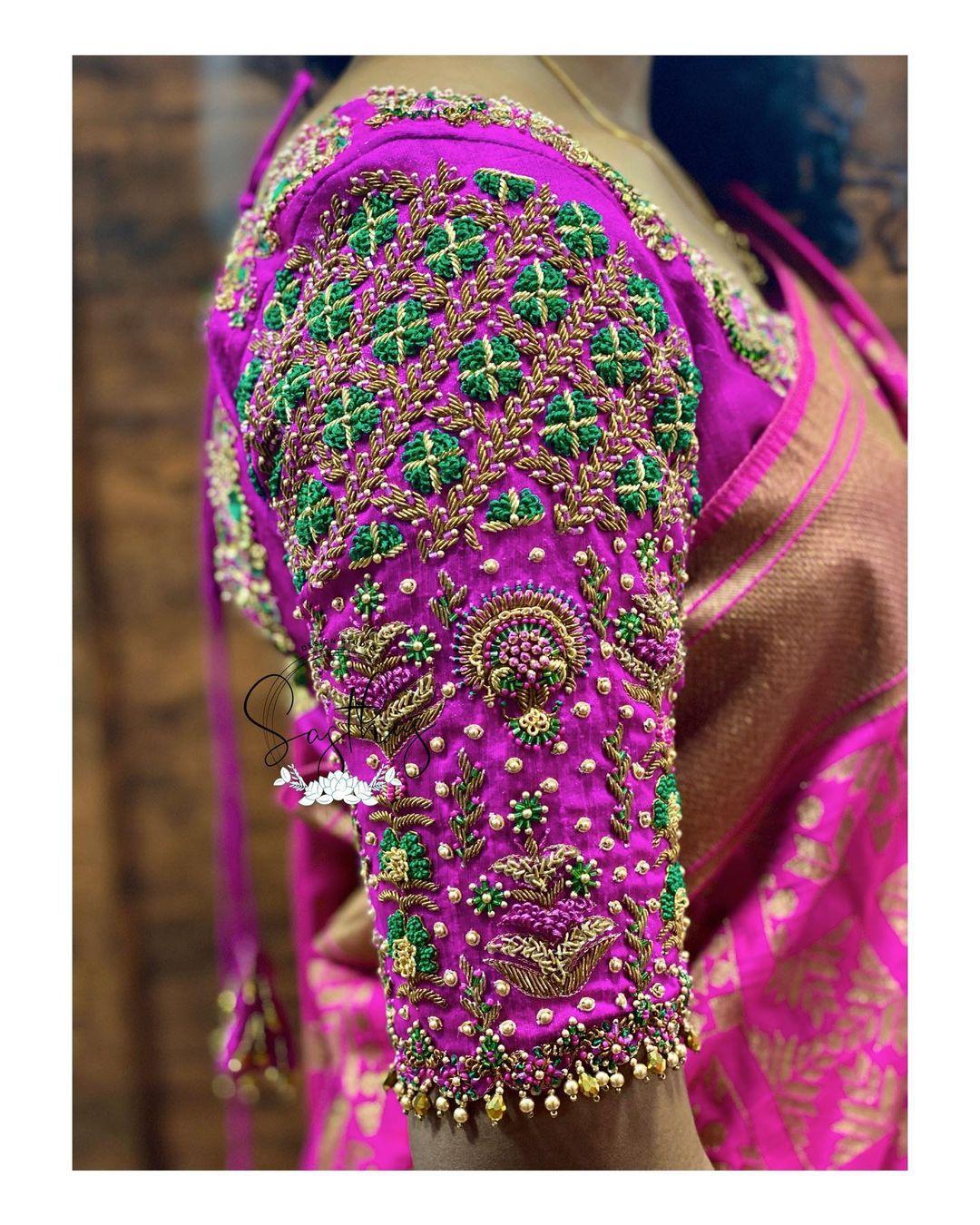 Beautiful purple color bridal blouse sleeves with floral bead aari work. 2021-06-17