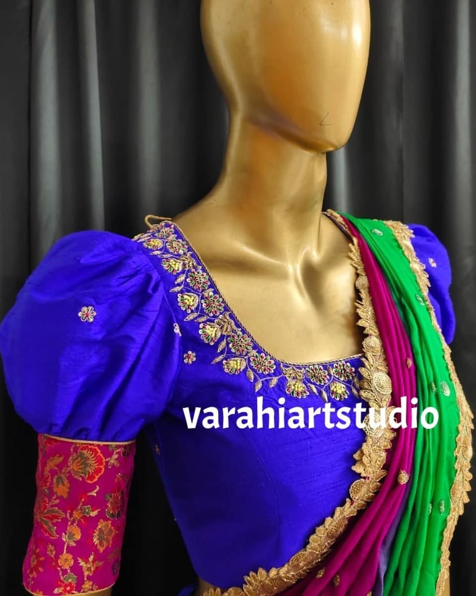Stunning blue floral pattu lehenga and puff sleeve blouse with net dupatta.  This outfit is Available at Rs 12800. 2021-06-17