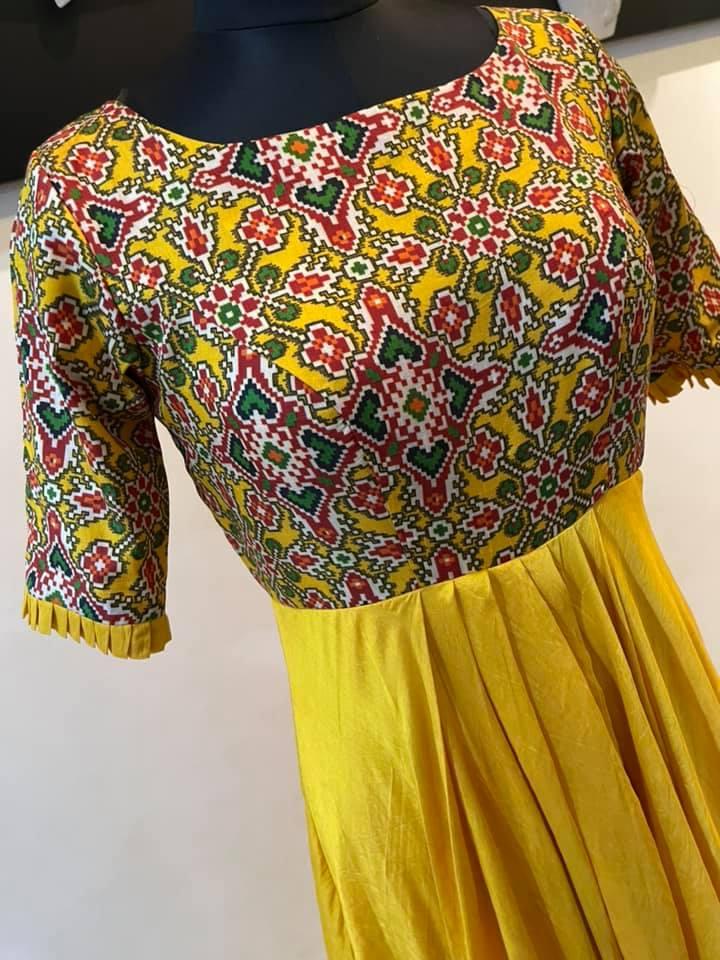 Stunning yellow color chandheri long frock. Price : 5500 INR. 2021-06-18