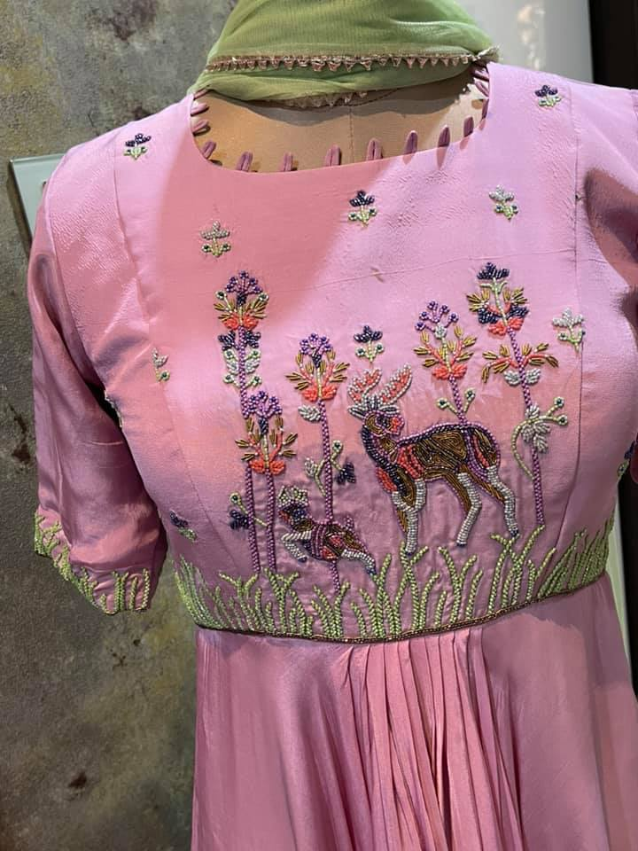 Stunning blush pink color asymmetric long frock with deer hand embroidery work on yoke.   2021-06-18