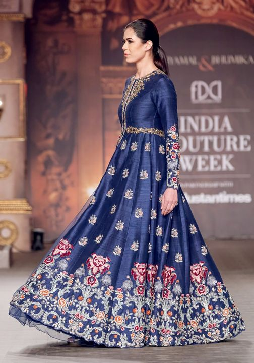 A muted royal blue classic  panelled jacket lehenga with rich contrast resham and golden tone embroidery. 2021-06-18