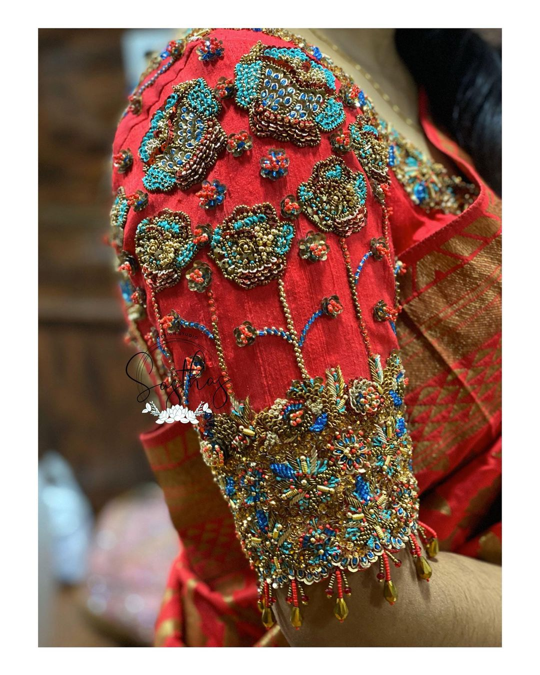 Beautiful rustic red color blouse sleeve design with floral hand embroidery bead aari work.   2021-06-18